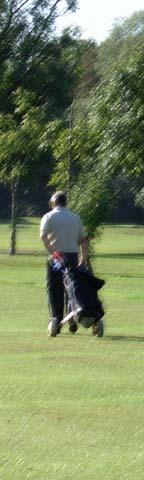 golfer heads up 2nd fairway